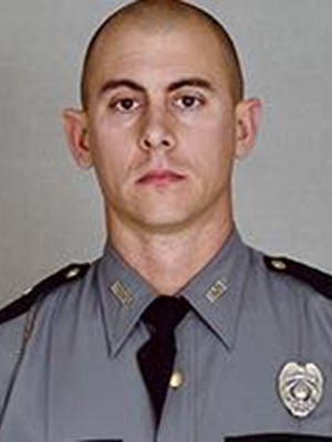 Kentucky Trooper Joseph Cameron Ponder, 31, was trying to help the occupants of a car he had pulled over when he was shot and killed, police said.