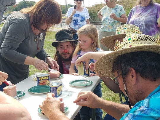 Hobo Fest attendees ready themselves to carve Spam during the 13th installment of the event on Saturday, Sept. 16, 2017.