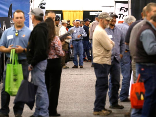 Four Corners Oil and Gas Conference attendees mingle on Thursday at McGee Park Convention Center in Farmington.