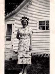 Betty Sufka Kowitz Chirhart stands in front of her Sartell home in the 1950s.