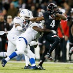 Cincinnati Bearcats running back Hosey Williams (4) breaks through a tackle in the second quarter during the NCAA college football game between the Tulsa Golden Hurricane and the Cincinnati Bearcats, Saturday, Nov. 14, 2015, at Nippert Stadium in Cincinnati.