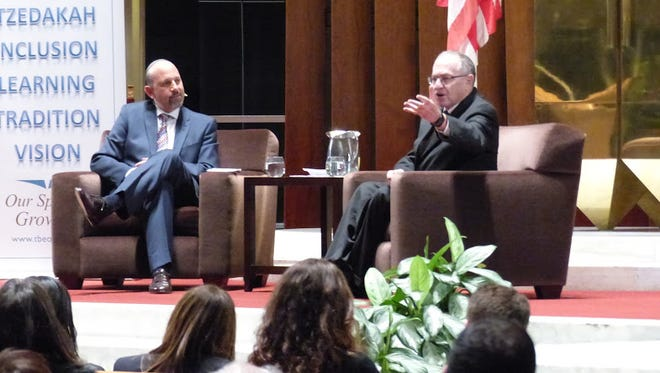 Senior Rabbi Mark Miller (left) interviewed Alan Dersowitz.
