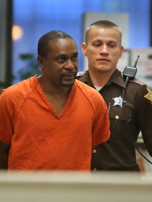 William Gholston, 48, is on trial in the slaying of 15-year-old Dominique Allen.