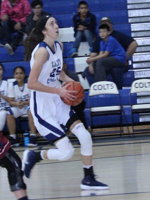Katelynn Limardo of the Lady Colts drives to the hole against Hot Springs. She had nine points.