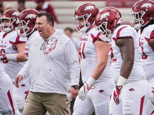 FILE - In this Saturday, Oct. 7, 2017, file photo, Arkansas head coach Bret Bielema joins his team on the field before an NCAA college football game against South Carolina in Columbia, S.C. Things don't get any easier in the near future for the Razorbacks, who face No. 1 Alabama this week and No. 10 Auburn next. Despite the tough road ahead, coach Bielema is doing his best to remain hopeful about both his and the team's future. (AP Photo/Sean Rayford, File)