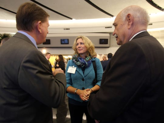 "Gretchen Driskell, a former state representative, center, speaks with Michael Rein and George Moroz during the ""Shining Light Regional Cooperation Awards""  breakfast Thursday, Oct. 9, 2014."