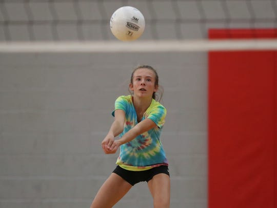Foothill High School sophomore Zoey Bishop returns a ball Wednesday during practice at the school in Palo Cedro.