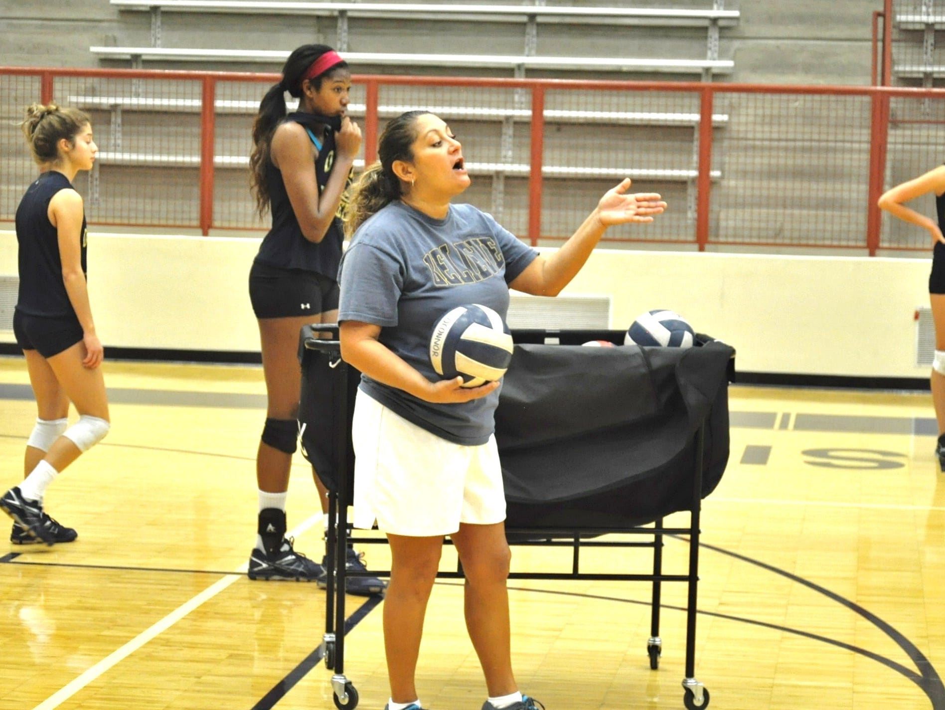 O'Connor volleyball coach Yamilet Garcia was a volleyball standout at Harlandale, where she was coached by her mother, Ninfa Garcia.