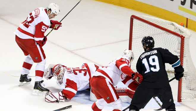 Detroit Red Wings goalie Jimmy Howard defends the goal behind a broken stick during the first period against the San Jose Sharks on Thursday, Feb. 27, 2015.