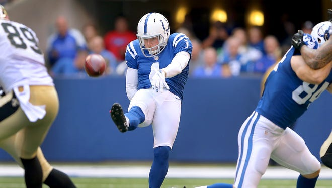 Indianapolis Colts punter Pat McAfee (1) gets a punt away during the first half of an NFL football game Sunday, Oct. 25, 2015, at Lucas Oil Stadium.