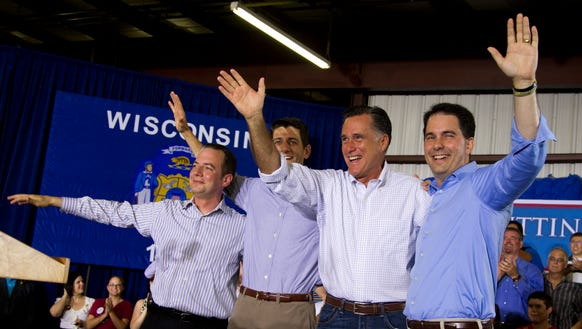 "Wisconsinites Reince Priebus, Paul Ryan, and Scott Walker share the stage with Mitt Romney during a campaign stop in 2012. At the time, the ""Big Three"" were building what became known as the Cheesehead Revolution in the Republican Party."