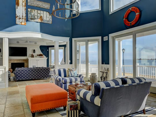 The mansion features sweeping views of Silver Bay.