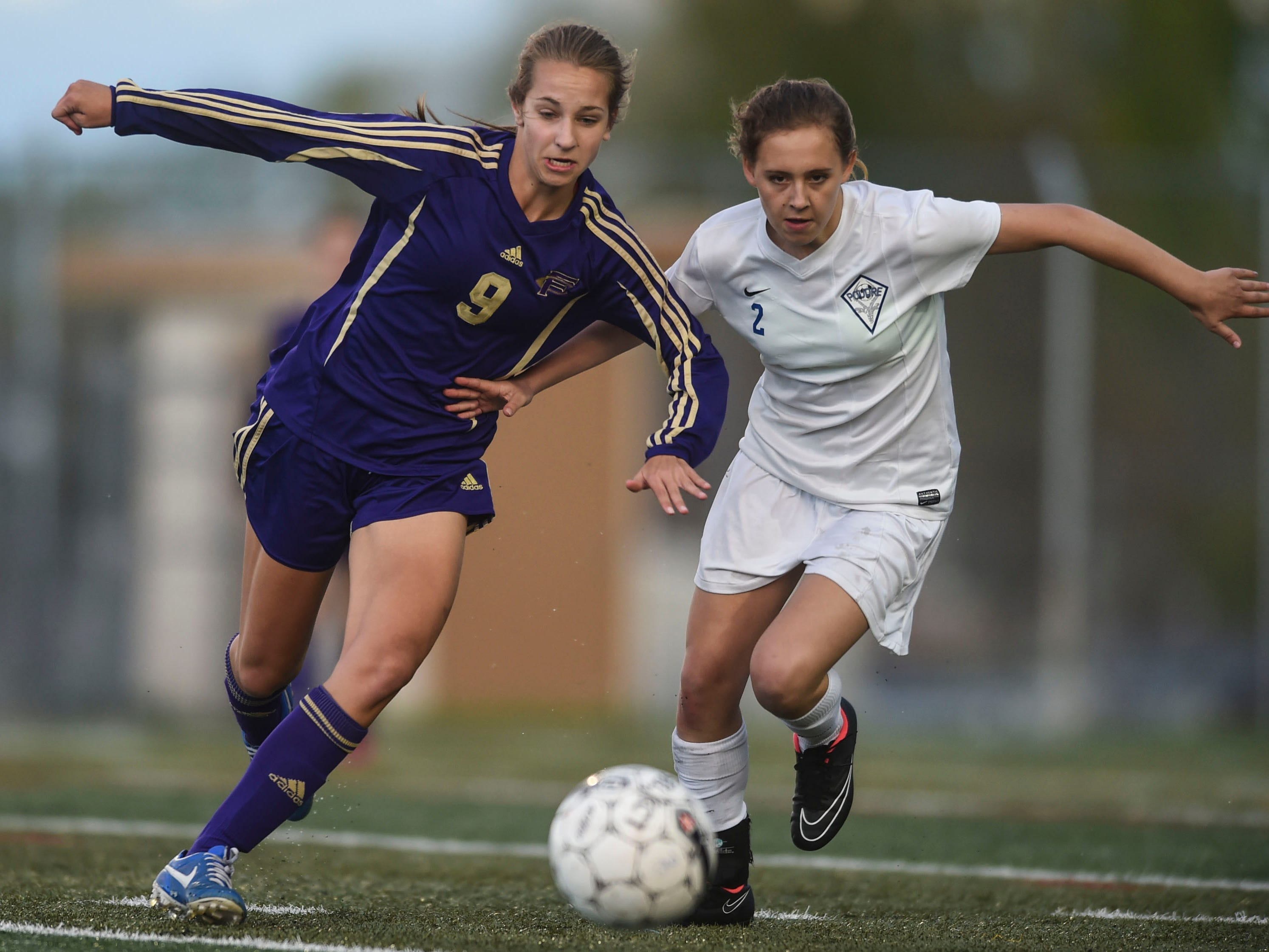 Fort Collins' Bailey Nemechek, left,and Poudre's Sierra Paulsen chase down a ball Thursday night during a game at French Field. Poudre won 2-1.