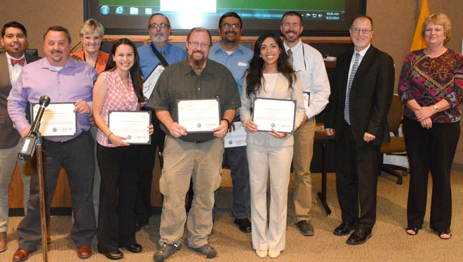 WSMR Executive Director Paul Mann, second from the right, and Mariette Mealor, far right, Reaching New Height and Executive Development Program director, pose for a photo with the 2015 graduates of the Executive Development Program. Back row from left to right, Abbott Chacon, Rhonna Hall, Thomas Maxwell, Rudy Pacheco, and James Thompson. Front row from left to right, Tim Worley, Mari Galaz, Jason Shankle, Nora Paz, Paul Mann, and Mariette Mealor. Also graduating but not pictured: Nigel Raynor and Joseph Trujillo.
