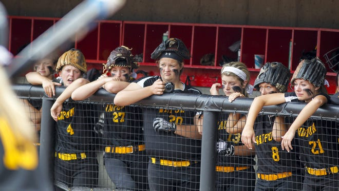 Waupun softball players look on in the seventh inning as they trail top-ranked La Crosse Logan in the WIAA Division 2 championship game Saturday at Goodman Diamond in Madison. The Warriors lost 3-0.