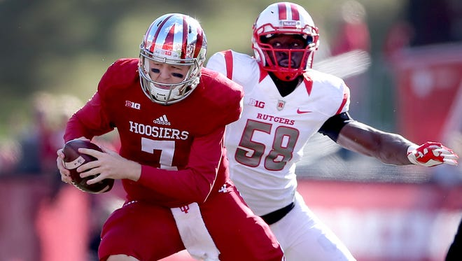 Indiana Hoosiers quarterback Nate Sudfeld (7) runs away from Rutgers Scarlet Knights defensive end Kemoko Turay (58) in the first half of their game. Oct 17, 2015; Bloomington, IN, USA; [CAPTION] at Memorial Stadium. Mandatory Credit: Matt Kryger-USA TODAY Sports