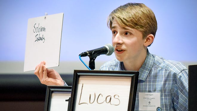 Lucas Eggers, a seventh-grader at STAR Homeschool Academy,  Minnetonka, answers the winning question to win the Minnesota State National Geograpic Bee Friday, April 1, in Ritsche Auditorium at St. Cloud State University.