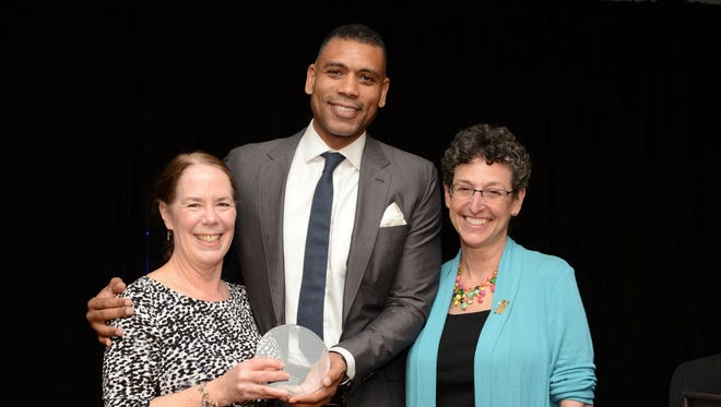 WCA President Cathy Draper, Allan Houston and WCA Executive Director Cora Greenberg.