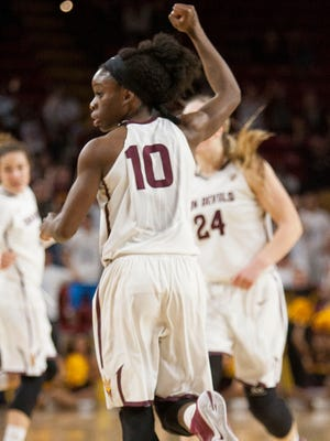 Arizona State's Promise Amukamara, 10, cheers as she runs down the court after teammate Katie Hempen made a three pointer to catch up to the Stanford Cardinals in the second half, Friday Feb. 6, 2015 at Wells Fargo Arena in Tempe, Ariz. The Sun Devils would take the win 53-52 over the Cardinals.