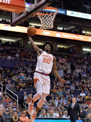 Phoenix Suns forward Josh Jackson (20) lays up the ball against the Orlando Magic in the first half at Talking Stick Resort Arena.
