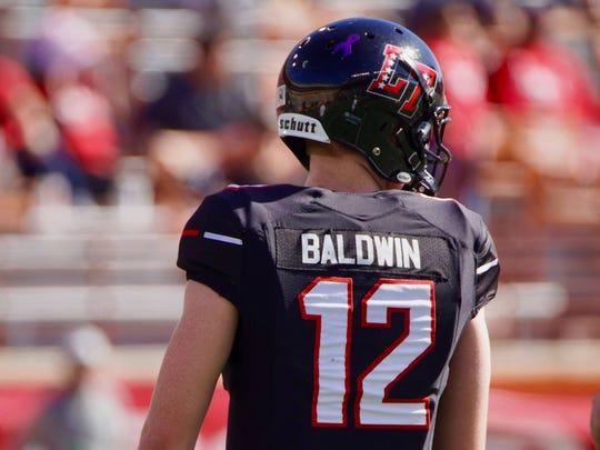 Matthew Baldwin stands on the field during Lake Travis'