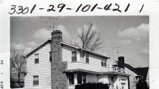 This home, located at 2126 Boston Ave., in Lansing, is one of the nearly 17,000 photographs in CADL's Local History Online City of Lansing Assessor Photograph Collection. The photo was taken in April of 1964.   The photo was taken in April of 1964.
