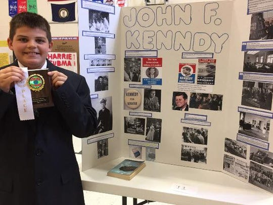 Luke Adams as John F. Kennedy with his third place prize.