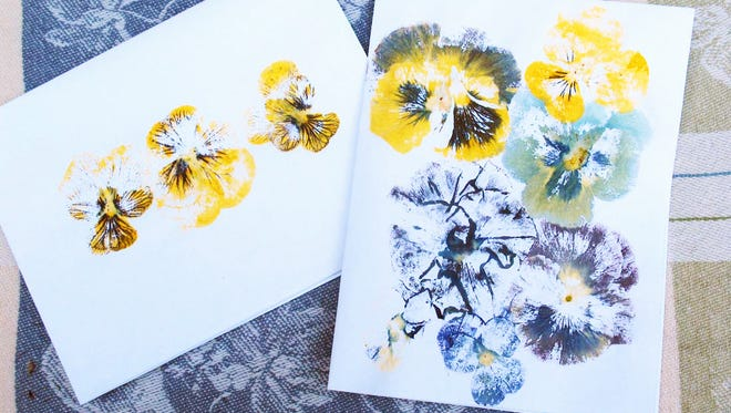 It's easy to make floral note cards using real flowers by pounding them with a hammer.