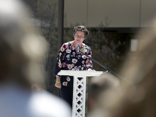 NAMI-Fox Valley executive director Maren Peterson talks during Monday's Mental Health Awareness Month kickoff program at Houdini Plaza in downtown Appleton.