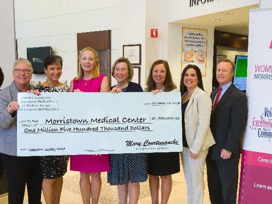 The Women's Association for Morristown Medical Center presents a check for $1.5 million to Morristown Medical Center representing funds raised from its 2017 Mansion in May Designer Showhouse and Gardens to benefit a Center for Nursing Innovation and Research at Morristown Medical Center. Pictured (left to right) are: Wendy Silverstein, Nurse Manager, Nursing Education, Shared Governance & Magnet, Mildred Kowalski, Nurse Researcher, Carol Jones, Chief Nursing Officer, Morristown Medical Center; Megan Cassie Schubiger and Katie Nolle, General Co-Chairs of Mansion in May 2017, Mary Courtemanche, President of the Women's Association for Morristown Medical Center, Trish O'Keefe, President, Morristown Medical Center, Brande Fetherman, Director of Nursing, Morristown Medical Center, James Quinn, Chief Development Officer, Foundation for Morristown Medical Center.