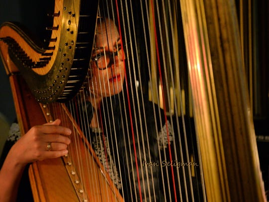 "Andrea Puente-Catan, harpist in the orchestra for ""Rappaccini's Daughter."" She was the wife of the late composer."