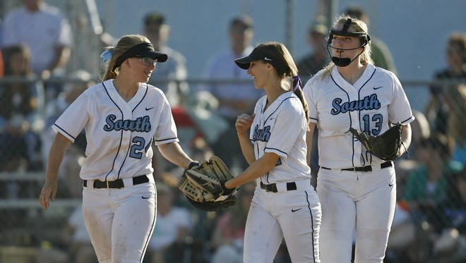 South Salem's Jessica Bohnstedt (from left), Kelly Burdick and Katie Donovan celebrate an out in the top of the seventh inning of the Saxons' 5-0 victory over Southridge in the quarterfinals of the OSAA 6A softball playoffs, at South Salem, on Friday, May 30, 2014.