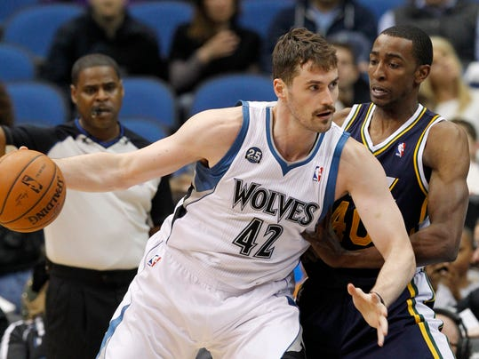 FILE - In this April 16, 2014 file photo, Minnesota Timberwolves forward Kevin Love (42) drives against Utah Jazz forward Jeremy Evans, right, during the first quarter of an NBA basketball game in Minneapolis. Two people with knowledge of the deal tell The Associated Press that Minnesota and Cleveland have agreed to a trade that will send All-Star forward Kevin Love to the Cavaliers for Andrew Wiggins, Anthony Bennett and a future first-round draft pick. The two people spoke Thursday on condition of anonymity because no official agreement can be reached until Aug. 23, when Wiggins, this year's No. 1 draft pick, becomes eligible to be traded. (AP Photo/Ann Heisenfelt, File)