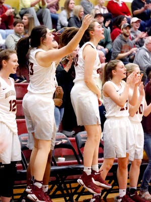 Riverdale players celebrate during Saturday's 78-38 Class AAA sectional win over East Hamilton. The Lady Warriors are in the state tournament for the third consecutive season.