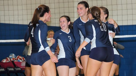 Lauren Owen-Ashe, third from right, played volleyball at East Henderson and then Montreat.