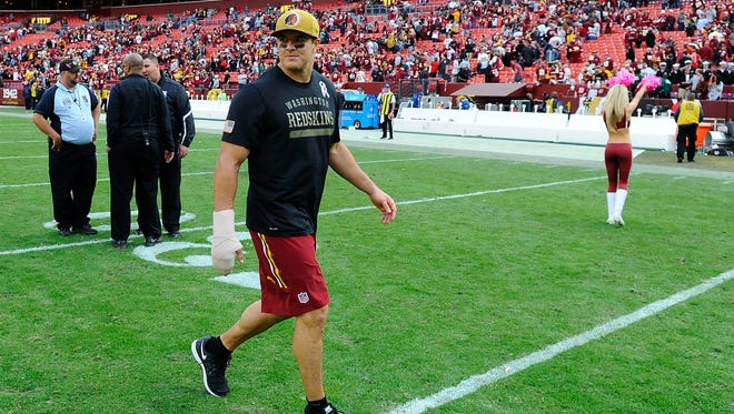Washington Redskins outside linebacker Ryan Kerrigan (91) walks off the field after suffering an injury against the Tampa Bay Buccaneers during the second half Oct. 25 at FedEx Field.