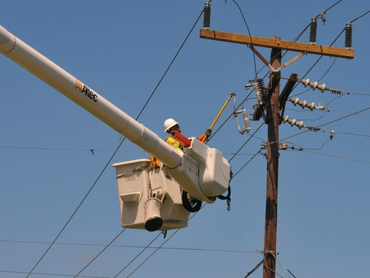 Workers from Extreme Powerline Construction out of