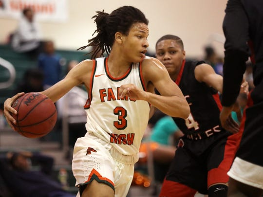 FAMU DRS' Mehki Yant drives to the lane against NFC