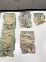 Police also seized hundreds of dollars in suspected