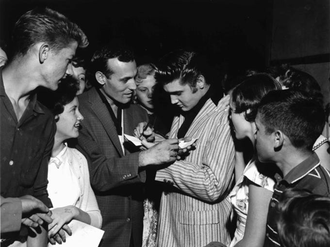 Elvis Presley and Carl Perkins swapped autographs on