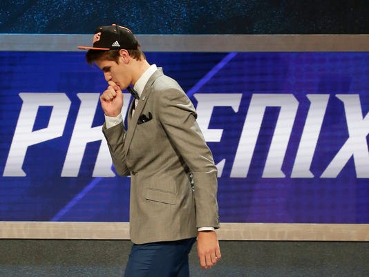 Dragan Bender walks off the stage after being selected fourth overall by the Phoenix Suns during the NBA basketball draft, Thursday, June 23, 2016, in New York. (AP Photo/Frank Franklin II)