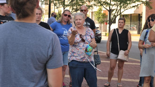 Patricia Casey gathers with other protesters against the mask ordinance outside city hall before the Columbia City Council meeting Monday.