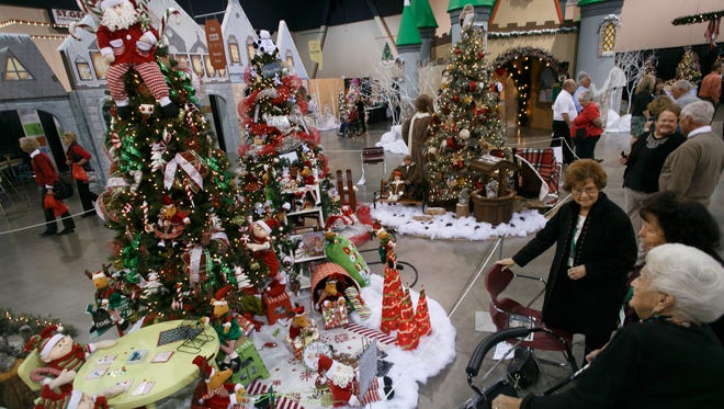 """Spectators at the 2014 Jubilee of Trees look over the entries, including one called """"Reindeer Games,"""" at the Dixie Center in St. George. This year's event runs from Nov. 19-23"""