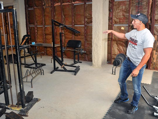 Dusty Gold, a professional wrestler and personal trainer, describes the layout of donated fitness equipment for a wrestling gym that is planned for the third floor of the First Wichita Building Annex above the Professional Wrestling Hall of Fame and Museum.
