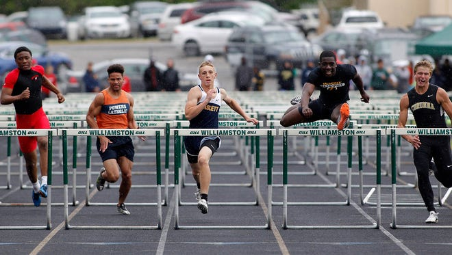 Waverly's Keshaun Harris, second from right, clears the final hurdle on the way to winning the 110-meter hurdles during the MHSAA Division 2 track regionals Friday, May 19, 2017, in Williamston, Mich. Also see are Sexton's Karl Brooks, left, Flint Powers Catholic's Kaden Nelson, Haslett's Quentin Hernandez, center, and Corunna's Cameron Welte, right.