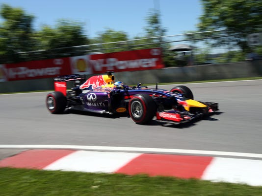 Red Bull driver Sebastian Vettel from Germany takes part in the morning practice session at Circuit Gilles Villeneuve Friday, June 6, 2014 in Montreal. The Canadian Grand Prix will be held Sunday, June 8, 2014. (AP Photo/The Canadian Press, Tom Boland)