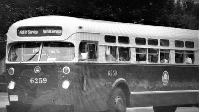Bus riders saw violence during 1953 labor unrest.
