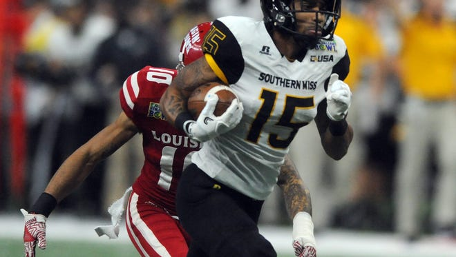The Southern Miss wide receiver Allenzae Staggers runs the ball against Louisiana-Lafayette quarterback Anthony Jennings  in the R + L Carriers New Orleans Bowl at the Mercedes-Benz Superdome on Saturday.