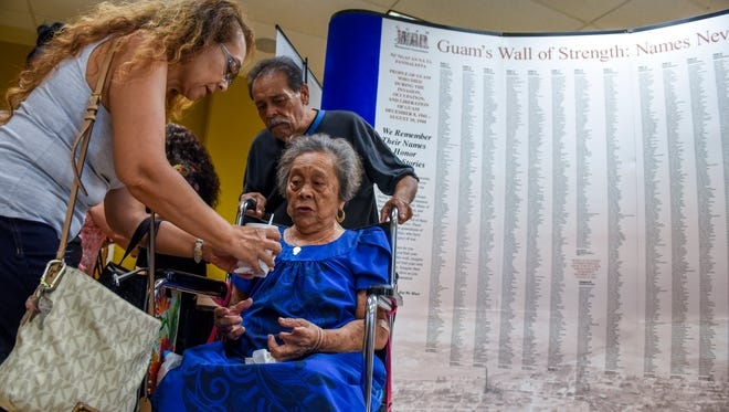 War survivor Luisa Borja, is accompanied by her daughter, Ester Topasna, and son, Greg Borja, as they attend an Independent Guåhan's Ayuda i Mañainå-ta Dos event at the University of Guam in Mangilao on Saturday, May 19, 2018. The event, held in a partnership with the Guam War Survivors Memorial Foundation, is to assist Guam war survivors in filling out war claim applications, which deadline is only a few weeks away on June 20.