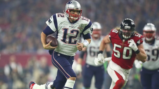 New England Patriots quarterback Tom Brady runs for a first down against the Atlanta Falcons in the third quarter during Super Bowl LI at NRG Stadium.